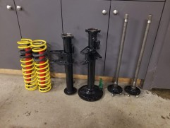 Half shaft tubes and coil springs ready for assembly